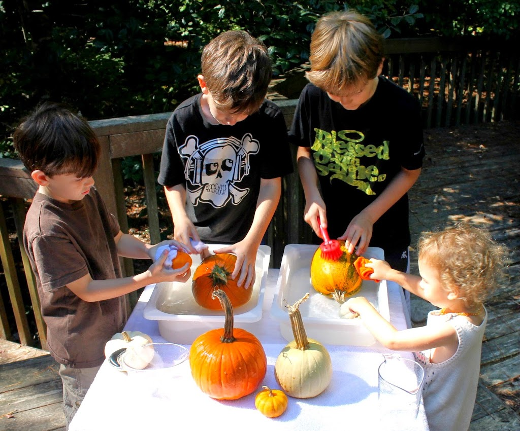 The Cutest Montessori Inspired Pumpkin Washing Station for kids, Perfect Fall Activity, Great Autumn Pictures and Montessori Quotes.