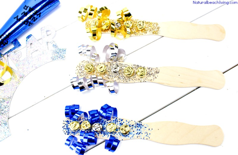 Easy New Years Eve DIY Noise Maker, How to Make DIY Spirit Noisemakers, homemade DIY noisemakers to make your New Year's Party awesome, New Year's Eve DIY Noise Makers for kids, homemade loud noise makers, #Newyearsevecraft #noisemakers #Newyearseveparty