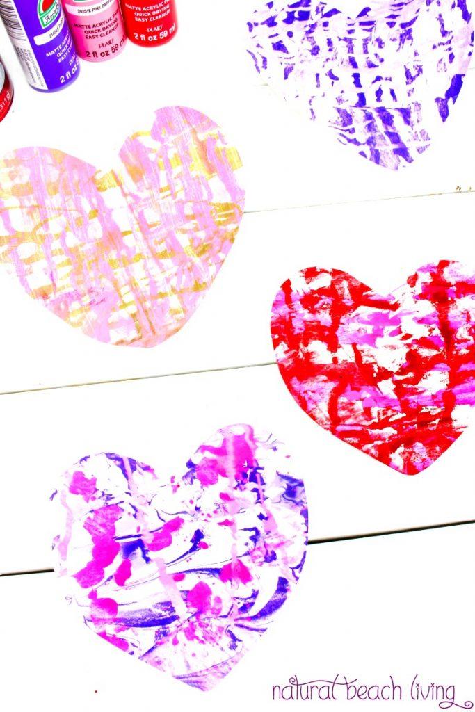 The Best Shaving Cream Art Kids Love, Marbled Paper Hearts, Easy art for preschoolers, DIY Marbled Paper, Shaving cream art for toddlers, Shaving cream marble art projects, Process art for kids, Shaving cream sensory play, Valentine's Day Art for kids, Homemade Valentine's Day cards, #Valentinesday #kidsactivities #preschoolcrafts #artsandcrafts #sensoryplay