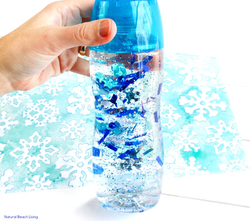 How to Make an Easy Winter Sensory Bottle that Kids Love, A wonderful Calming Sensory Bottle, Blizzard in a bottle, Winter Sensory Bottles for toddlers and preschoolers, Winter Sensory Table Ideas, Winter Sensory Activities, Sensory Bottles for Kids, Winter preschool themes, #winteractivitiesforkids #sensoryplay #preschoolactivities