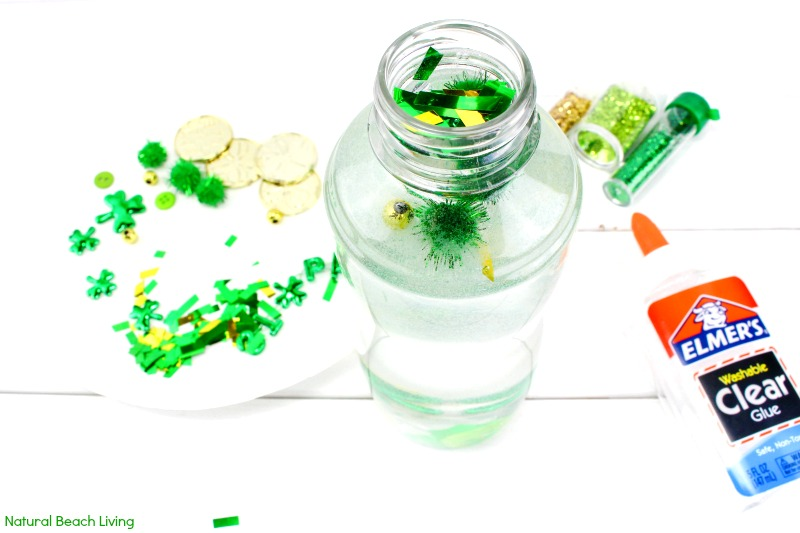 How to Make St. Patrick's Day Sensory Bottles, Easy Sensory Bottles for Kids, These DIY sensory bottles for preschool are an easy sensory play idea, Science Bottles, Discovery Bottles, Easy Glitter sensory bottles ingredients for your Science Table, St. Patrick's Day Activity, STEM, St. Patrick's Day Preschool Theme