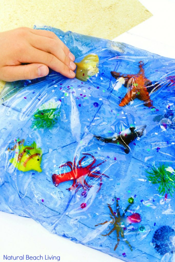 Easy Ocean Life Sensory Bag for toddlers and preschoolers, Your kids will love Mess-Free ocean themed sensory activities, Fun Hands On Activities for an Ocean Theme and this ocean sensory bag is perfect for Ocean Science Table Ideas and Under the Sea Activities