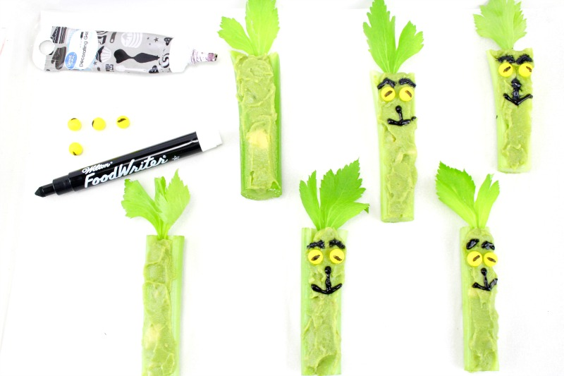 Healthy Grinch Snacks, Grinch Food, Grinch Christmas Treats that are healthy treats for kids and adults. Serve these up for a Grinch Party food or an afternoon snack for the kids. Munching on Grinch Celery Snacks is a delicious, healthy treat everyone can eat.