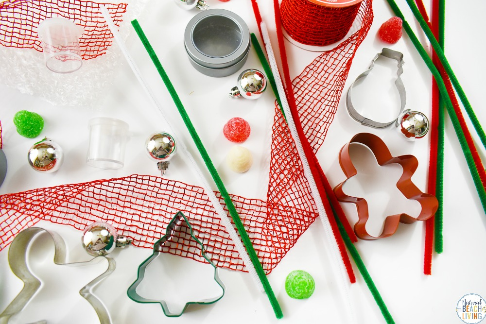 Santa's STEM Activities for Kids, this Santa's STEM Activities idea is perfect for holiday hands on activities, Santa's STEM Activities for Preschoolers, Christmas STEM, have your countdown to Christmas start with a STEM box or Christmas Tinker Tray. Free STEM Printable