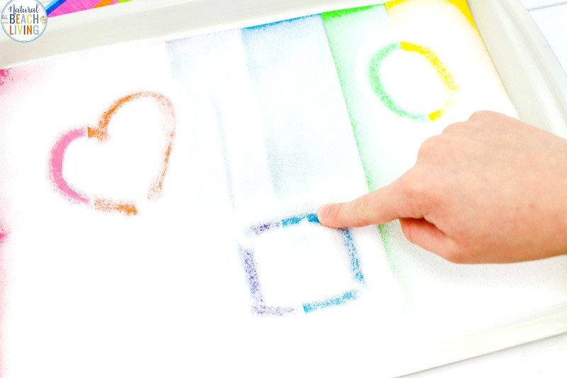 A Rainbow Salt Tray is a fun way to improve pre-writing skills, Children can use a Montessori Salt Tray and sensory writing trays for Preschoolers, Sensory activities keep children engaged and learning in a fun hands-on way. multi-sensory activities for preschoolers