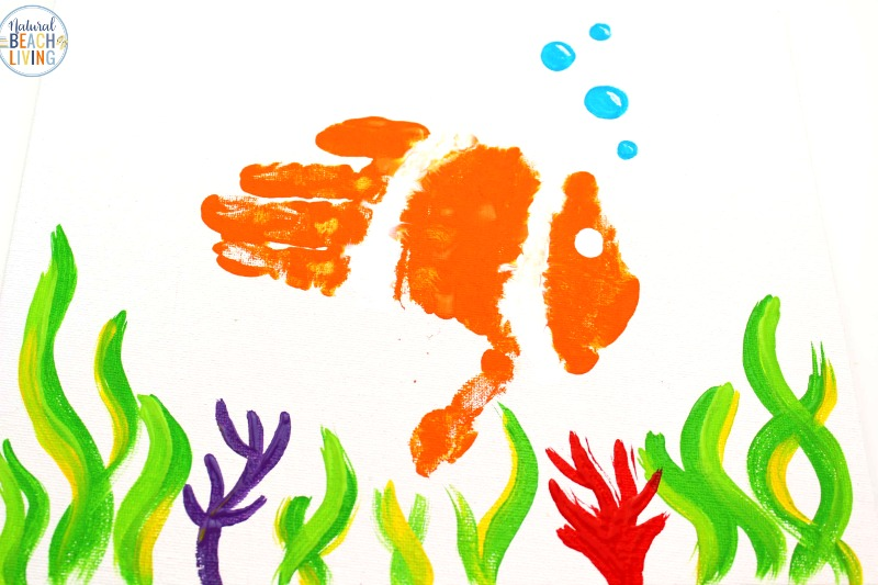These Handprint Fish Crafts are one that your child is going to love. You can also use this fish craft for a preschool fish theme, an ocean theme, under the sea craft or Letter F week. There are so many fun ways to incorporate this fish handprint craft into your plans. Fish crafts for preschool