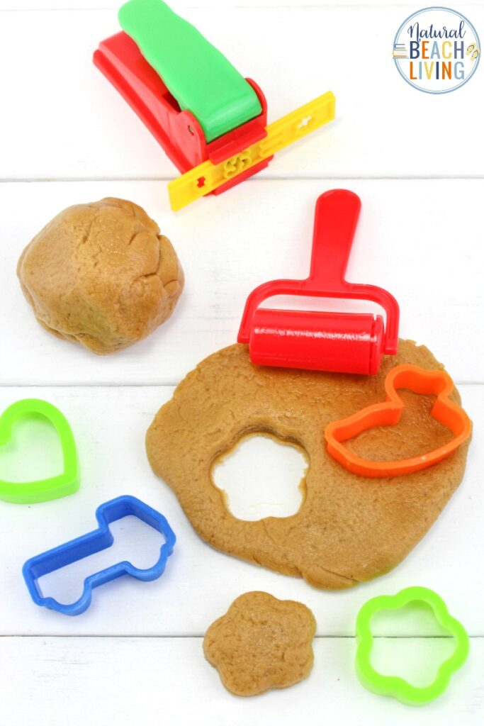 This Peanut Butter Playdough is so simple and easy to make! All you need are three ingredients and you'll have a fun sensory activity perfect for toddlers and preschoolers. This Peanut Butter Playdough with marshmallows is The Best Edible playdough around. Make this Peanut Butter Playdough Recipe Soon.
