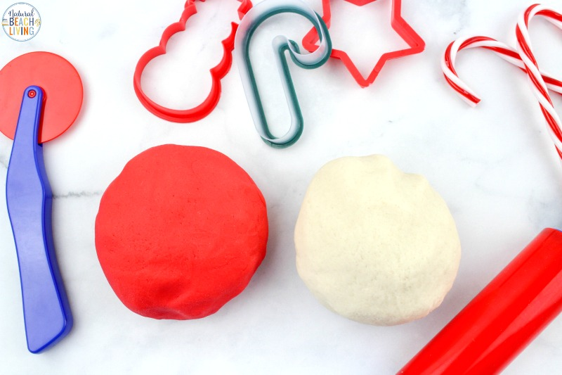 This Candy Cane Playdough recipe is so much fun! Peppermint Playdough smells great and looks just like a candy cane once it's created and ready! Gather up your playdough supplies and great ready to make a truly awesome Scented Playdough. Homemade Playdough for Christmas