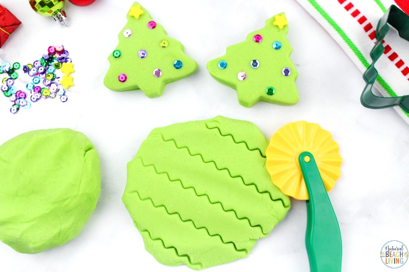 You're going to want to add this Christmas Playdough to your holiday activities!  This Homemade Playdough is easy to make and using Christmas Playdough cutters is a lot of fun!  How to make playdough from gingerbread playdough to peppermint to cranberry to snow dough and more, it's all here!