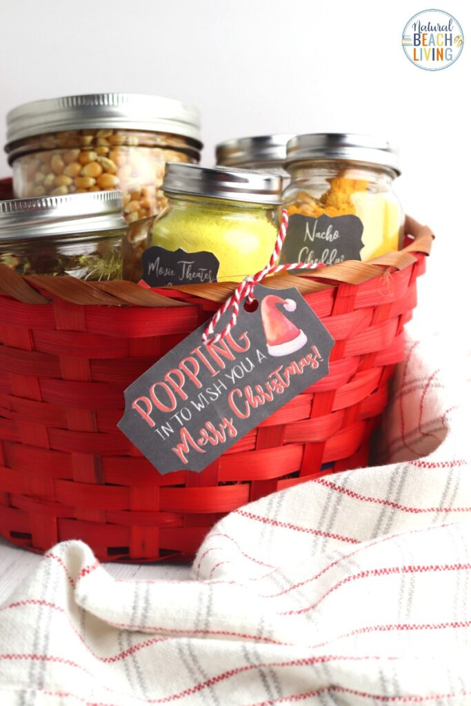 This Popcorn DIY Christmas Gift Basket is such an awesome homemade gift idea! Everyone loves popcorn and this gift gives your friends a fun movie night gift idea. The Free Popcorn Labels make Creative Christmas gifts so cute! Make up a DIY Popcorn Gift Basket with this Homemade Christmas Gift Idea. DIY Christmas Gifts, DIY gift baskets, Cheap homemade gift basket ideas for kids and adults.