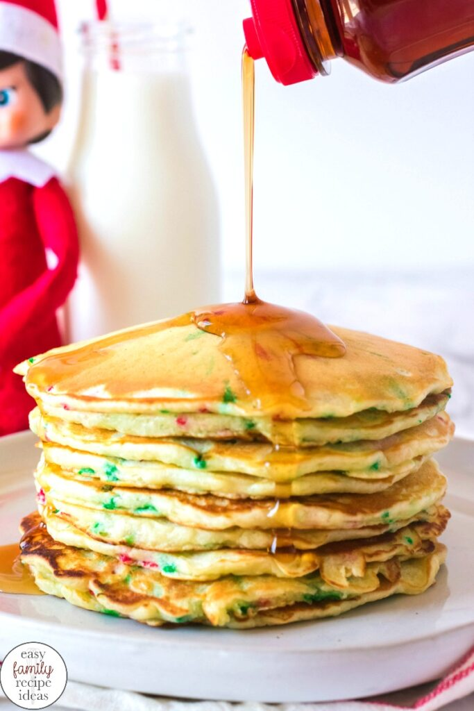 You're going to love this Elf on the Shelf Pancake Breakfast! It's a fun recipe that gets everyone cooking together in the kitchen! There isn't much better than eating Christmas pancakes? make homemade pancakes with your children to add fun and magic of the elf on the shelf. This Elf on the Shelf ideas will make your whole family happy.
