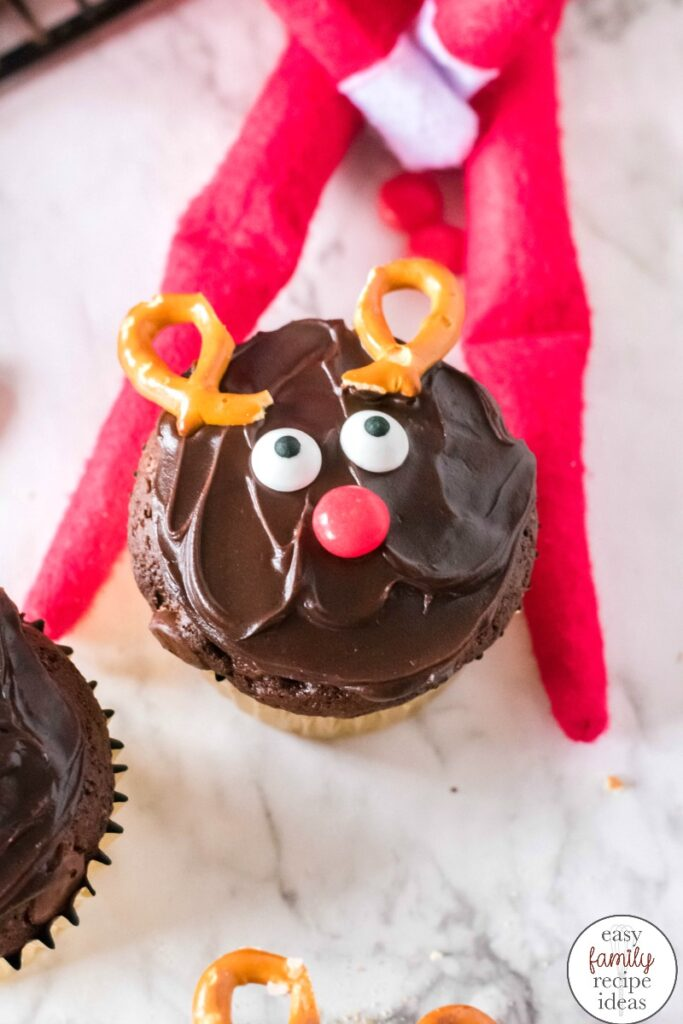 Check out THE BEST Elf on the Shelf Baking Cupcakes idea that everyone in the family is certain to love! It's a simple way to have fun and eat a yummy Christmas dessert. The Cutest Reindeer Cupcakes for your Elf on the Shelf Baking Ideas, and an easy Christmas Cupcakes Idea