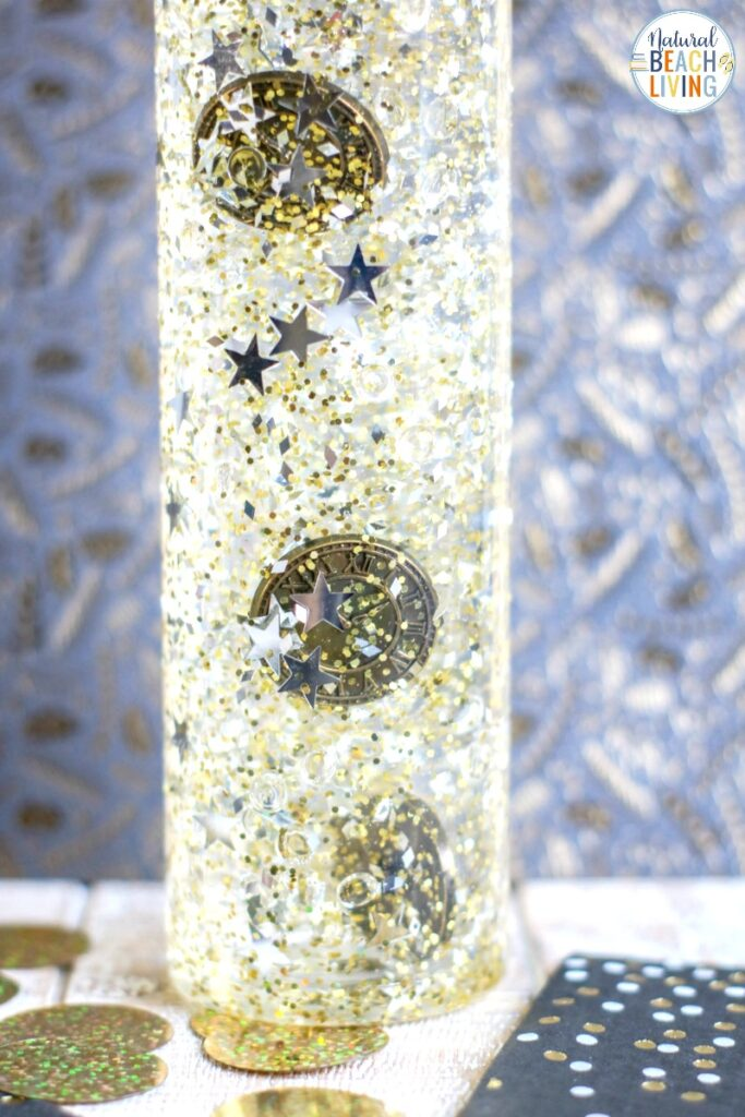 Consider making this New Year's Sensory Bottle this year for your child. It's an easy sensory bottle that is certain to provide them with tons of calming sensory play. These New Year's Eve Activities for preschoolers and Winter Sensory Bottles are so much fun, Find Sensory Bottles for Holidays and a variety of themes Here.