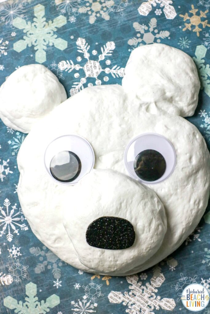 This Polar Bear Fluffy Slime is easy to make and It's a great winter indoor activity that encourages imagination and a fun sensory activity. This Snow Slime is just the cutest snow slime recipe, ever. Make this Fluffy Slime Recipe to add to a Winter Preschool Theme. Fun Polar Bear Craft