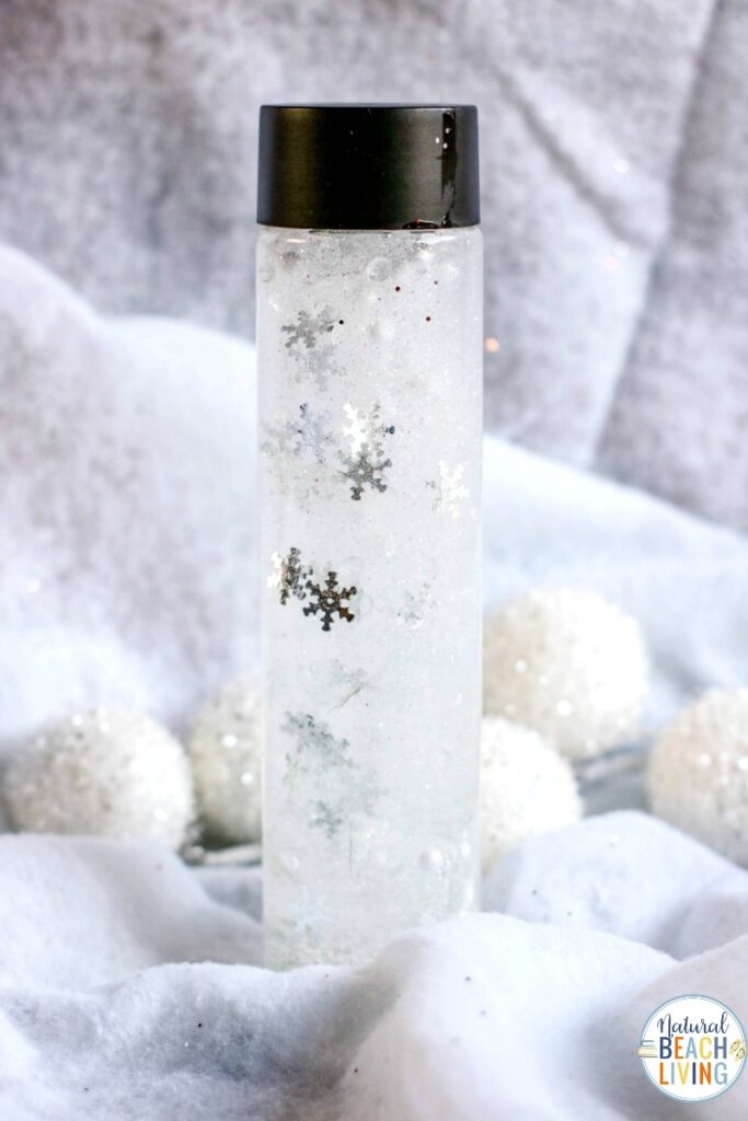 You'll love making these Snow Sensory Bottles for all your winter sensory play. So simple to make and certain to provide hours of fun. All you need are a few supplies and your toddlers will enjoy these beautiful calming sensory jars. In fact, this snow sensory play activity is one of the best indoor snow day ideas, ever. Winter Sensory Bottles