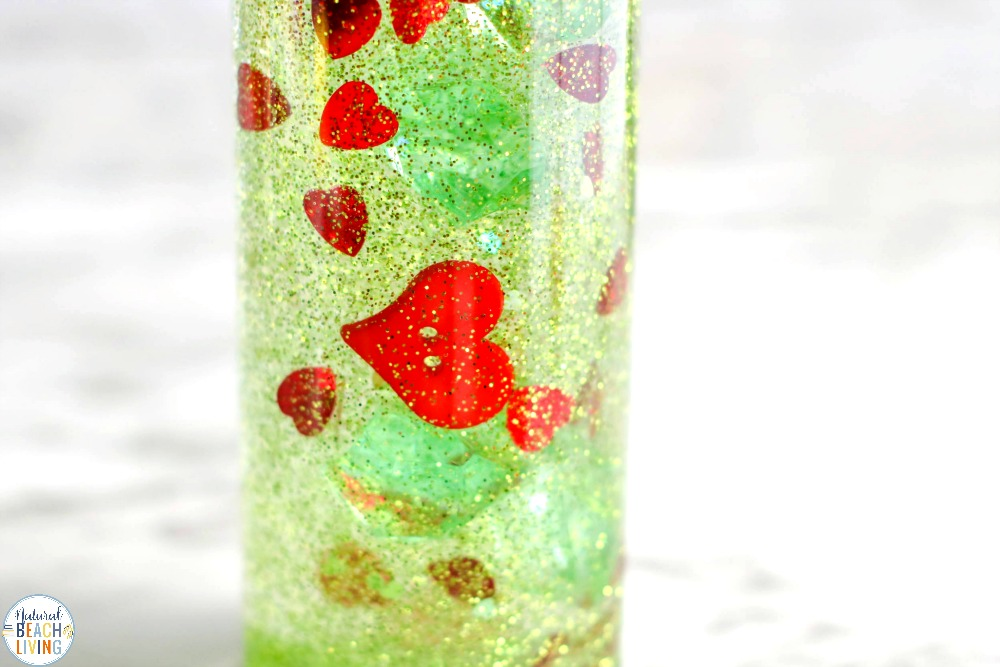 The Grinch Sensory Bottle is a great way to include awesome sensory play during the holidays. Have fun making these Winter Sensory Bottles with your child today! Children love Christmas Sensory Bottles and any Calming Sensory Bottles to use all year.