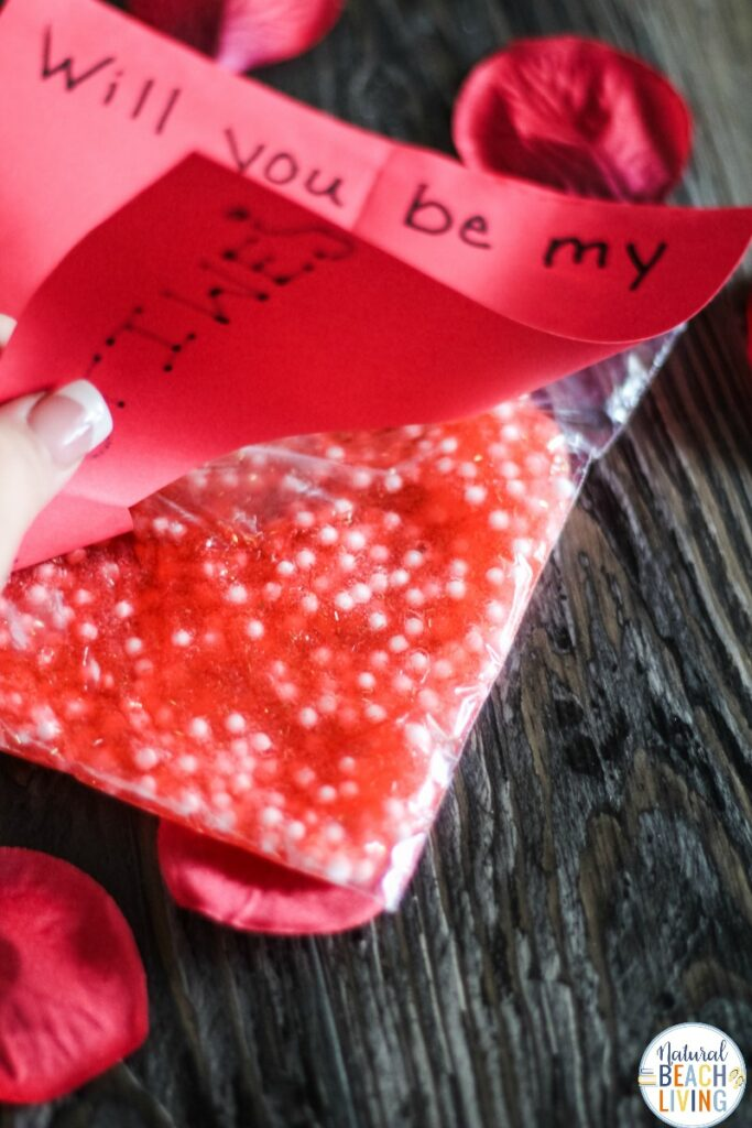 This Valentines Day Slime Card is so simple and easy to make. Plus, it's a unique Valentines Day Slime Recipe and easy Valentine Crafts for Preschoolers. This Valentine's Day Floam Slime is an awesome sensory activity and a super cool Kid Valentine Card, Use this Valentine Craft idea for a Preschool Valentine Theme Kids Love!