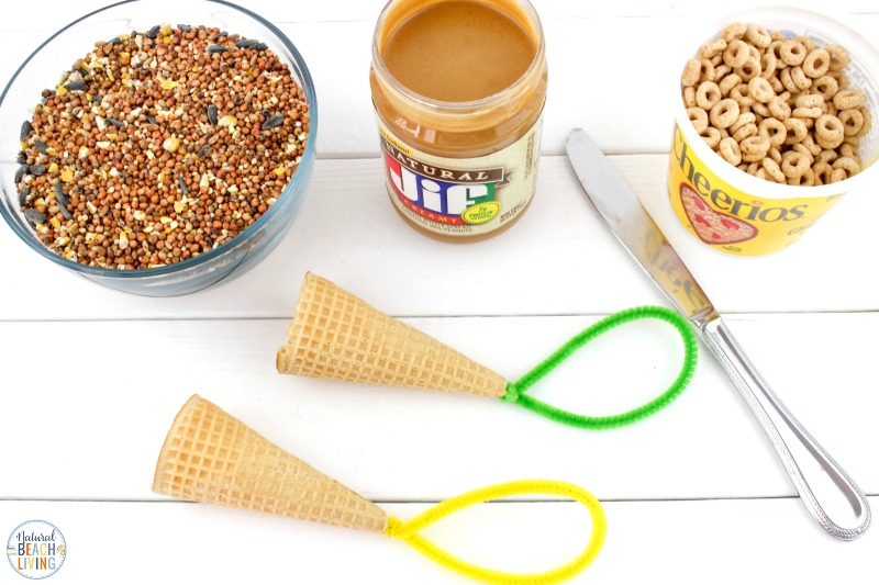 This Ice Cream Cone Bird Feeder is such a simple project. Perfect for Spring, Summer, Earth Day, or any time of the year. Your backyard birds are certain to be happy with these Bird Seed Ornaments! This is a super fun Kid Made Bird Feeder with only a few ingredients. See how to make a bird feeder with over 30 homemade bird feeders