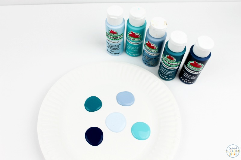 You'll love this Ocean Art Preschool Activity! It's a great way to talk about the ocean and be creative at the same time. A simple art activity that teaches painting with different textures, shades of blues, makes a great Earth Day Art or any under the sea theme idea. Process art is always a great activity to include into your preschoolers day.