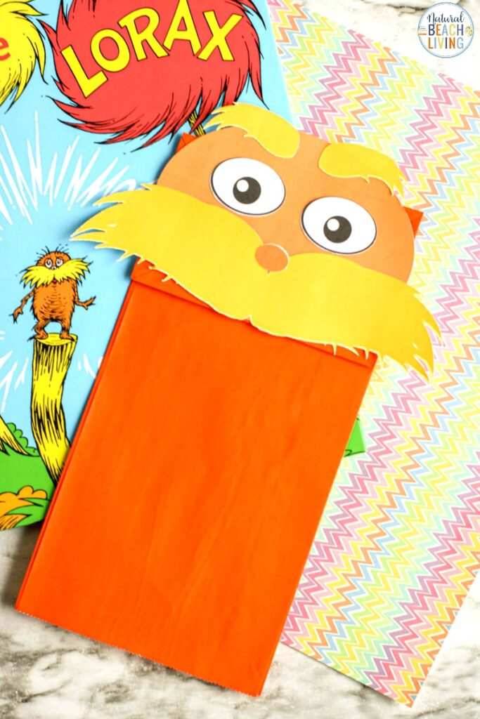 Everyone loves creating The Lorax Paper Bag Puppet! It's such a fun and simple activity. If you are looking for Dr. Seuss Activities, are celebrating Dr. Seuss' birthday, or want a fun preschool craft to make, The Lorax Paper Bag Craft with Free Lorax Template is perfect for you.