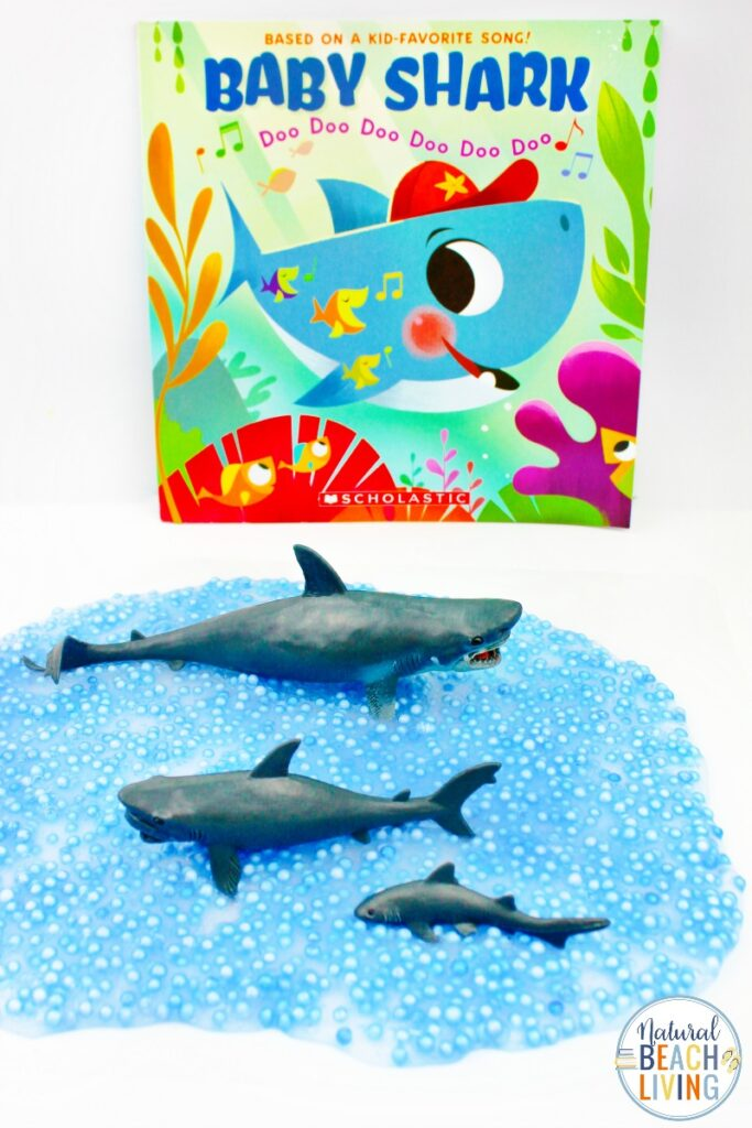 This Shark Slime is a great shark activity for Shark Week! Plus, the texture of this easy slime recipe will have the kids loving it! This clear slime recipe is an easy slime recipe plus every toddler and preschooler loves Baby Shark Activities.